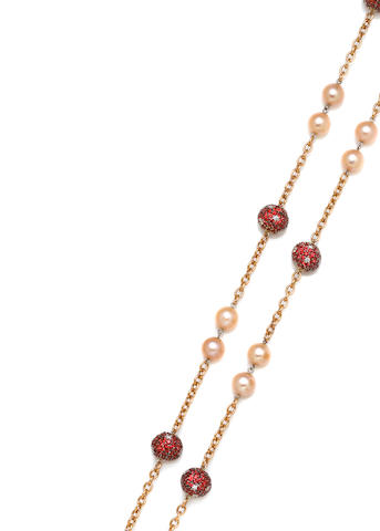 A colored cultured pearl, orange sapphire and diamond necklace