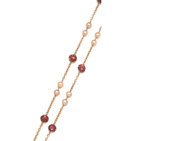 A colored cultured pearl, orange sapphire and diamond necklace