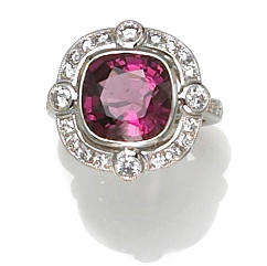 A purple-pink spinel and diamond ring