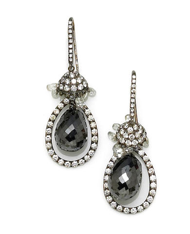 A pair of black diamond and diamond pendant earrings