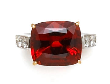 A hessonite garnet and diamond ring