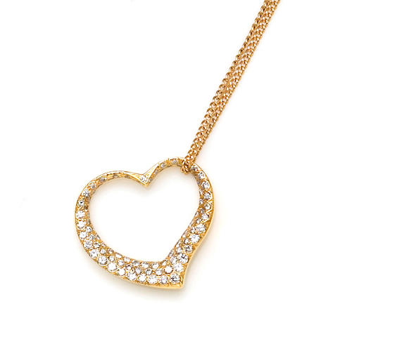 A diamond and eighteen karat gold heart pendant