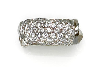 A diamond and eighteen karat white gold chain ring