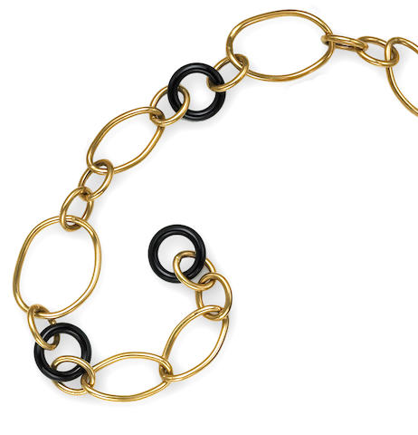 A black onyx and eighteen karat gold necklace