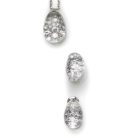 A rock crystal and diamond pendant with chain together with matching earrings, Cartier, French