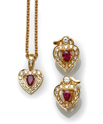 A ruby and diamond heart motif pendant with chain together with a matching pair of earrings, Fred, Paris