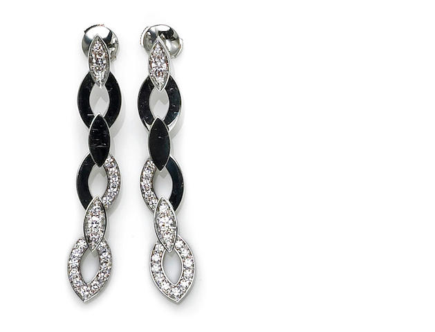 A pair of diamond and eighteen karat white gold navette link earrings, Cartier, French