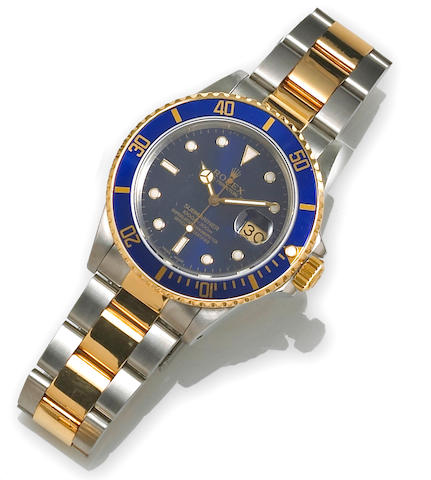 Rolex. A stainless steel and 18k gold wristwatch