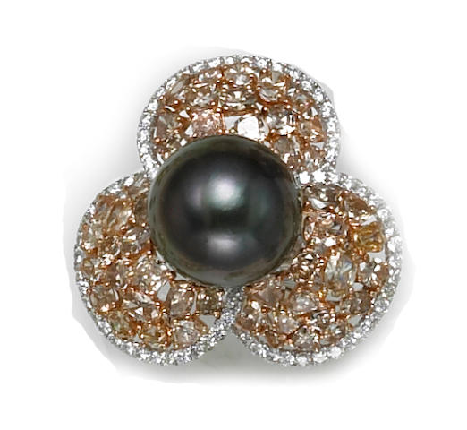 A colored South Sea cultured pearl, colored diamond and diamond flower ring