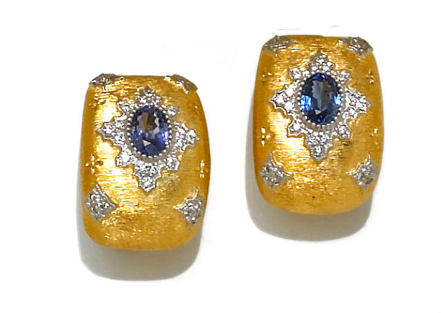 A pair of sapphire, diamond and eighteen karat bicolor gold earrings