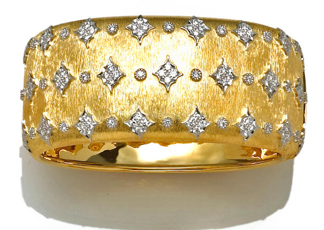 A diamond and eighteen karat bicolor gold bangle bracelet