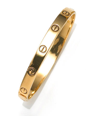 """An eighteen karat gold """"Love"""" bangle bracelet, Aldo Cipullo, Cartier,"""