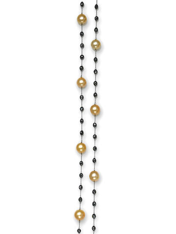 A colored cultured pearl and black diamond necklace