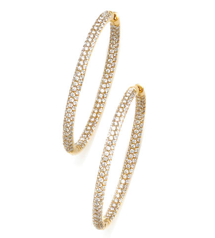 A pair of diamond pavé-set oval hoops