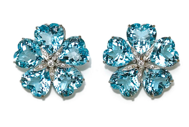 A pair of aquamarine and diamond flower earclips, Michael Kanners