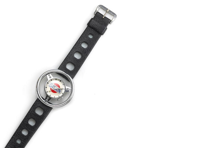 Swiss. A nickle plated metal Datsun steering wheel wristwatch