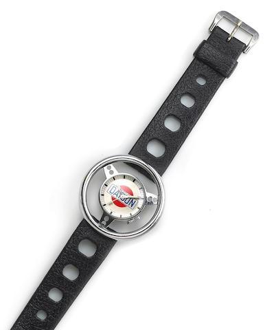 Swiss. A nickle plated metal Datsun steering wheel wristwatch