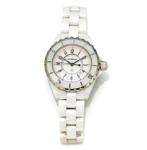 Chanel. A stainless steel and ceramic calendar bracelet wristwatch