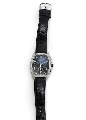 Longines. A stainless steel automatic chronograph calender wristwatch with diamond bezel and lugs