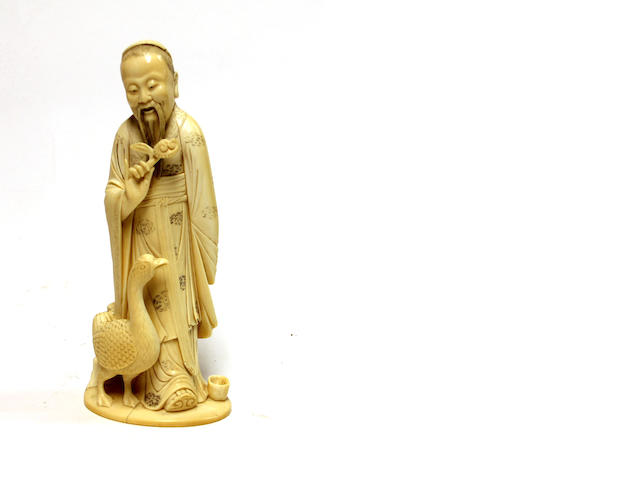 A Chinese ivory figure of a scholar holding lingzhi and standing beside a goose, Circa 1900