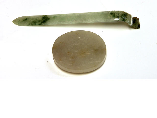Two jade decorations: a mottled green jade Manchu lady's hairpin and an oval white Chinese belt buckle
