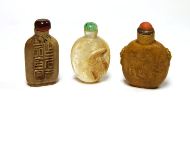 A group of three Chinese snuff bottles: mother of peal lotus and phenix, soapstone with calligraphy and unusual molded brown glazed porcelain