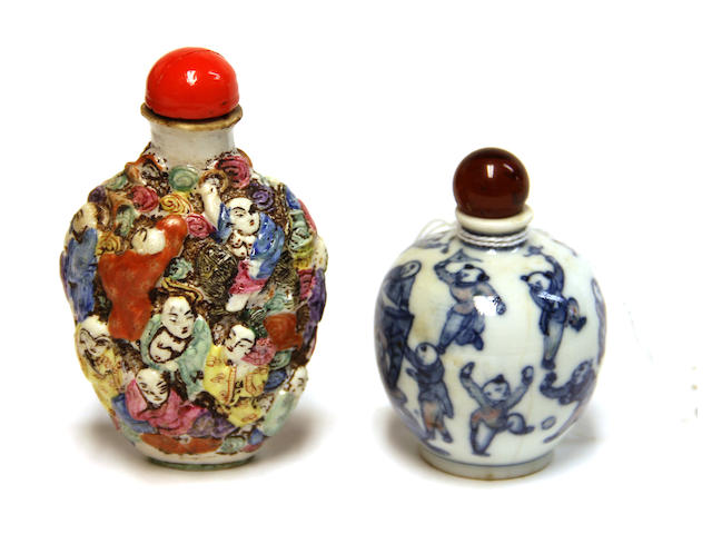 A Chinese molded porcelain snuff bottle with Lohan and a blue and white porcelain snuff bottle, Yongzheng mark