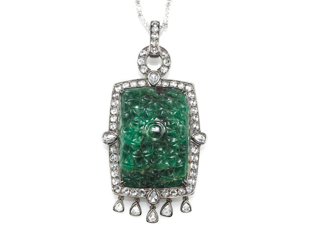 A carved emerald and diamond pendant with diamond chain