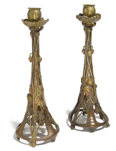 A pair of Art Nouveau bronze poppy candlesticks