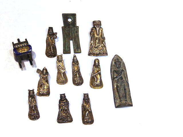 A group of miniature Asian metal decorations