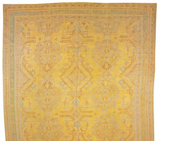 An Oushak carpet West Anatolia size approximately 15ft. 2in. x 22ft.