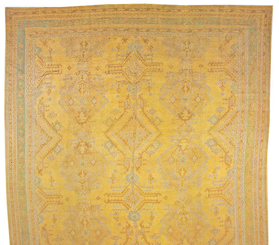 An Oushak carpet West Anatolia size approximately 15ft. 2in. x 22ft.