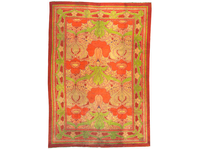 An Arts & Crafts carpet size approximately 5ft. 8in. x 11ft. 9in.
