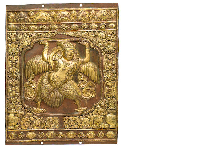 A gilt copper alloy repoussé relief plaque with Kinnara  Tibet, 17th century