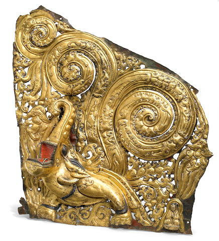 A gilt copper repoussé makara panel Tibet, circa 15th century