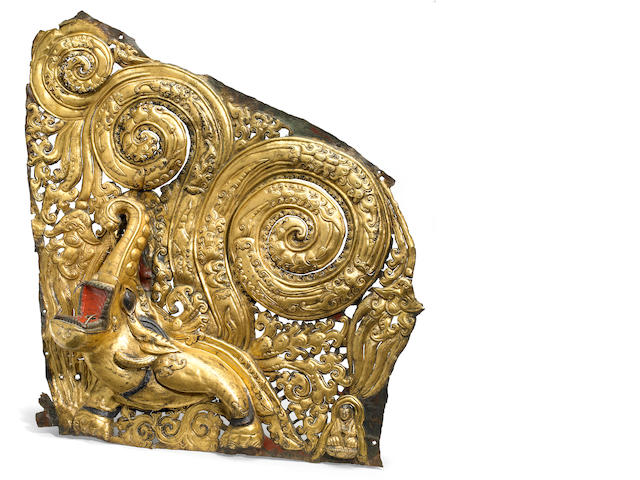 A gilt copper repousse makara panel Tibet, circa 15th century