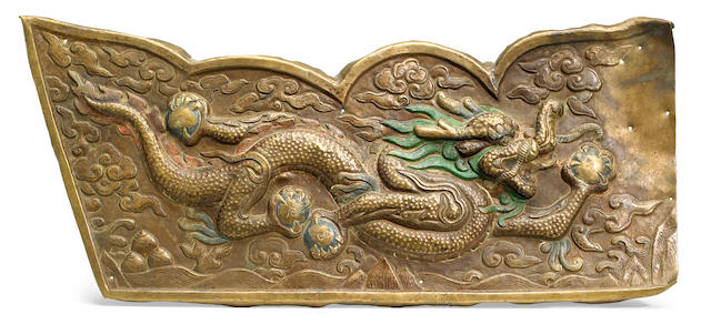 A gilt copper repousse panel with a Dragon Tibet, 18th century