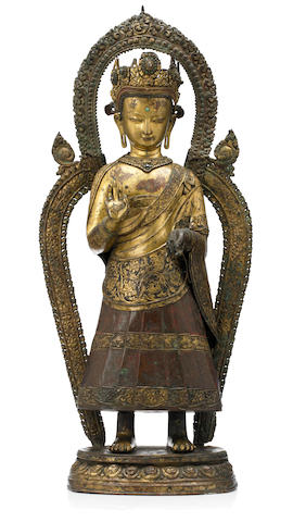 A gilt copper repoussé figure of Dipankara  Buddha Nepal, circa 17th century