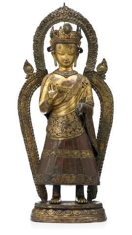A gilt copper repoussé, Dipankara  Buddha Nepal, circa 17th century