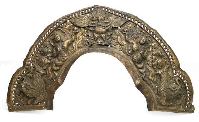 A gilt copper repoussé prabhamandala arch Tibet, circa 18th century