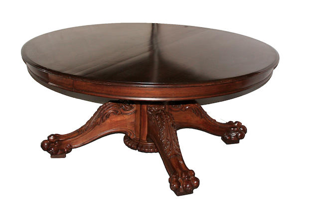 A Regency style carved mahogany dining table