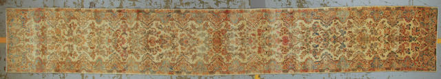 A Kerman runner South Central Persia size approximately 2ft. 10in. x 19ft. 4in.