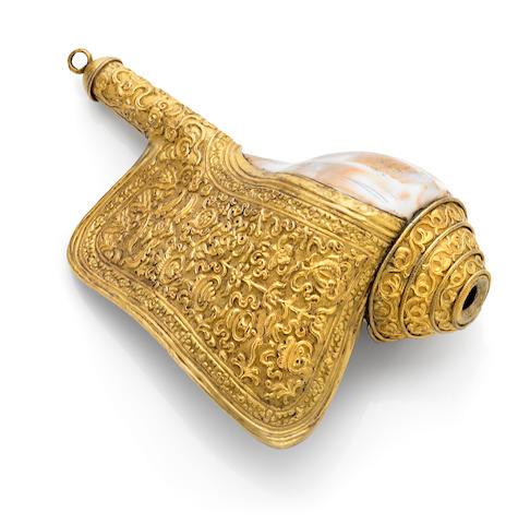 A gilt copper alloy repoussé ritual conch trumpet Tibet, circa 18th century