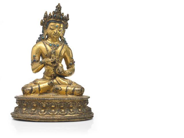 A gilt copper alloy Vajrasattva Khasa Malla region, Tibet/Nepal, 13th/14th century