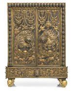 A parcel-gilt silver repoussé and gilt copper alloy miniature shrine cabinet (torgam) Tibet, circa 18th century