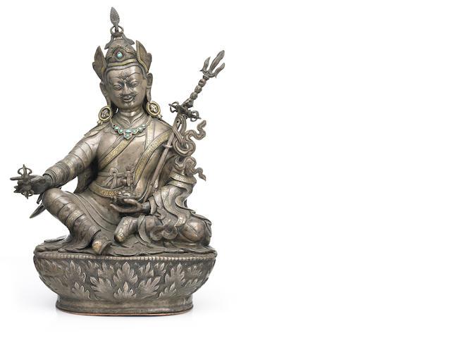 A parcel silver gilt, cast and repoussé figure of Padmasambhava Tibet or Mongolia 18th century