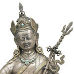 A parcel-gilt silver, cast and repoussé figure of Padmasambhava Tibet or Mongolia 18th century