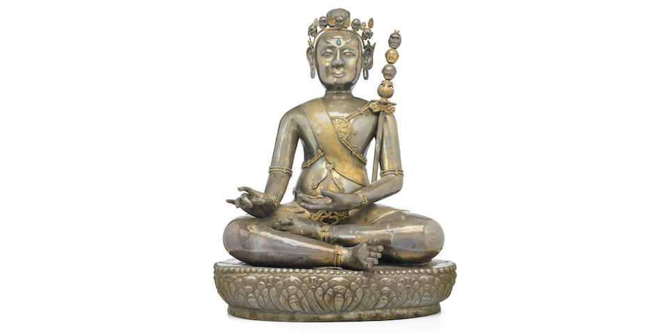 A parcel-gilt silver repoussé figure of Padmasambhava in the aspect of Nyima Oser Tibet, 18th century