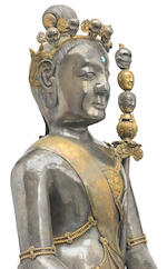 A parcel silver gilt repoussé figure of Padmasambhava in the aspect of Nyima Oser Tibet, 18th century