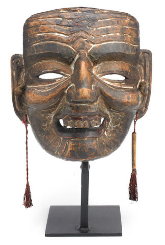 A carved wooden dance mask of Hwa Shang Eastern Himalayas, 19th century